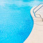 Beautiful luxury outdoor swimming pool in hotel resort - Vintage Light Filter